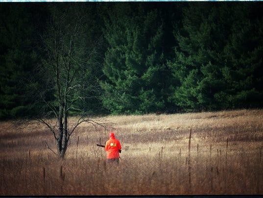 Deer Hunter in field near Eagle