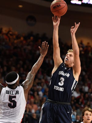March 10, 2015; Las Vegas, NV, USA; Brigham Young Cougars guard Tyler Haws (3) shoots the basketball against Gonzaga Bulldogs guard Gary Bell Jr. (5) during the second half in the finals of the West Coast Conference tournament at Orleans Arena. Mandatory Credit: Kyle Terada-USA TODAY Sports