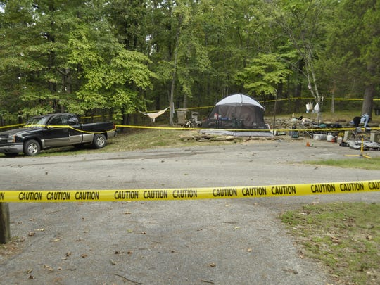 Crime scene tape surrounds a campsite at Buffalo Point Campground where authorities say John W. Prickett Jr. shot his wife, Tommie Prickett, multiple times with a .40-caliber pistol. John Prickett is being held on a criminal attempt to commit first-degree murder.