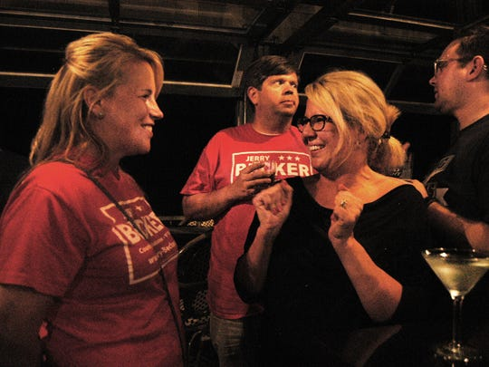 Sibyl Bass Reagan, one of the organizers of the grassroots group Strong Schools, celebrates with Stacey Becker, left, at The Rudder.