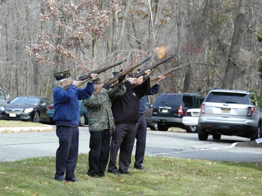 Members of the Firing Squads from the American Legion Posts 245 and 423; Jefferson Township, fire a salute in honor of the members of the Military and Veterans who have passed away since the previous Veterans Day.