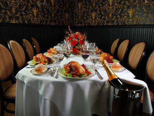 A Thanksgiving meal is served in one of the dining rooms of Whispers, a restaurant in a Victorian hotel in Spring Lake.