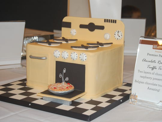 An oven-inspired cake from Premier Pastry is available for auction at the 2014 Home Sweet Home Cake Auction.