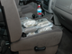 Packages of heroin sit on the passenger seat of a pickup