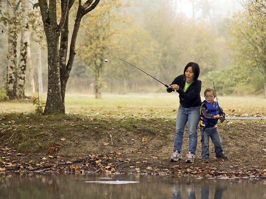 Amy Kobus and her son Andrew fish for trout at an Oregon Department of Fish and Wildlife youth fishing event at St. Louis Ponds near Gervais in 2014.