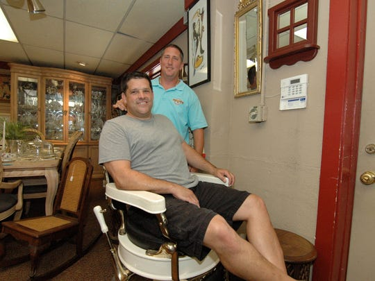 Treasures in the Attic  business partners Wayne Maver and Dan Flagg. Wayne sit in a 1960's vintage barbershop chair at their storefront location.  Treasures in the Attic is an estate clean-out business with a retail storefront on Route 206 in Tabernacle.