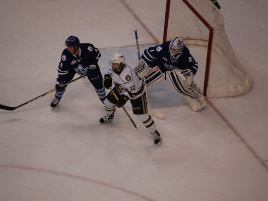 Nathan Walker sets up in front of the net during the