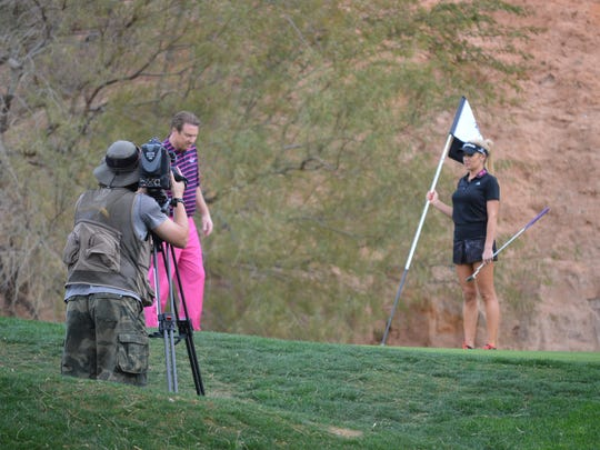 LPGA golfer Natalie Gulbis (right) films an episode of 18 Holes with Natalie Gulbis and Jimmy Hanlin.