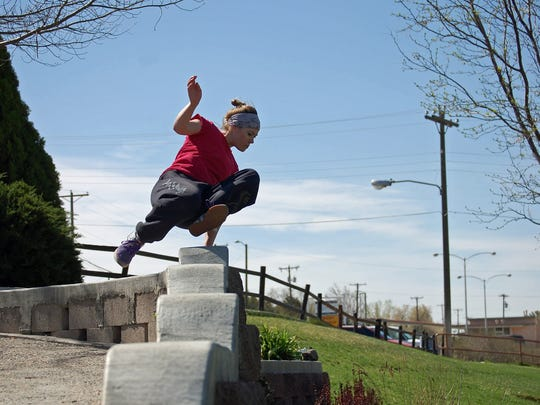 Natalie Keil vaults a wall while practicing parkour