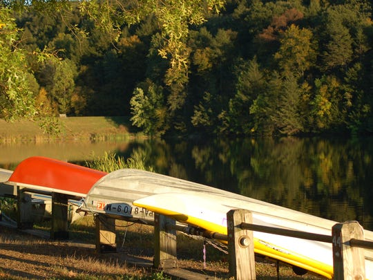 A row of canoes are ready to be used at Little Buffalo State Park in Perry County.
