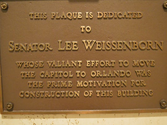 This plaque on the first floor of the new capitol pays tribute to Florida Sen. Lee Weissenborn, D-Miami. In 1967, Weissenborn sponsored a bill in the legislature to move the capital to Orlando. The bill failed, ending a century long attempt to move the Florida capital to a more centrally located city. But Weissenborn's efforts spurred Tallahassee in 1968 to host the first Springtime Tallahassee festival, an annual event that emphasizes the charms of Tallahassee.