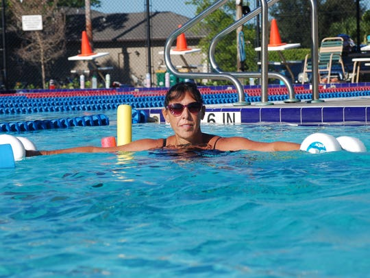 Nancy Stolliker participates in an Aqua-Fit session