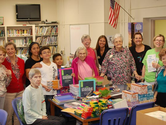 Brandywine Living residents with students from Stony Brook Elementary School in North Plainfield collect supplies for students,