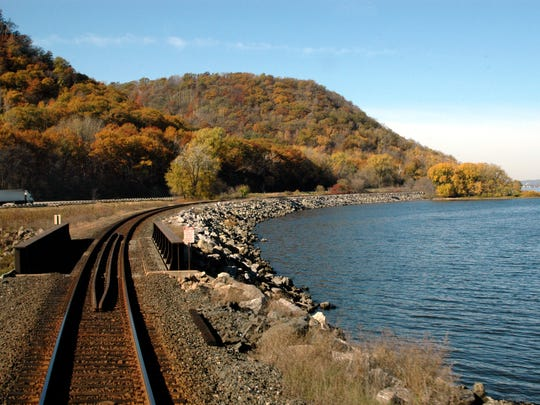 Fall colors frame a railroad line along the Mississippi