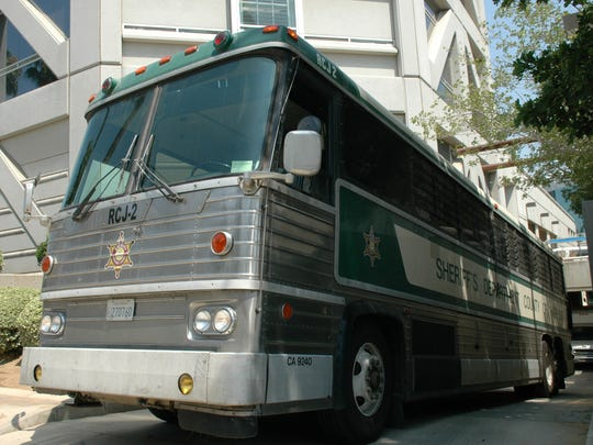 A Riverside County jail bus, just like the one that transfers fed kicked inmates so they can be released, is photographed at the Riverside jail.