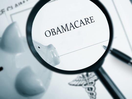 Magnifying glass over Obamacare policy.