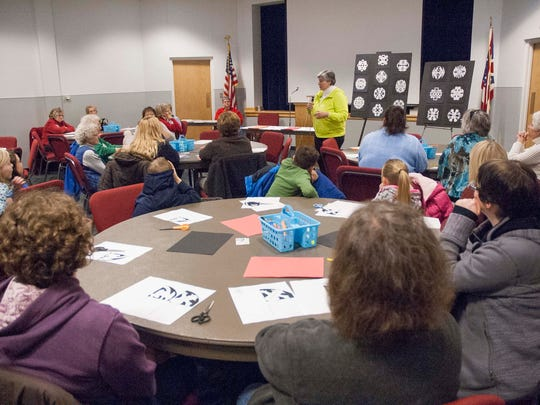 Mary Gaynier leads a past snowflake workshop at the Hayes Presidential Library & Museums.