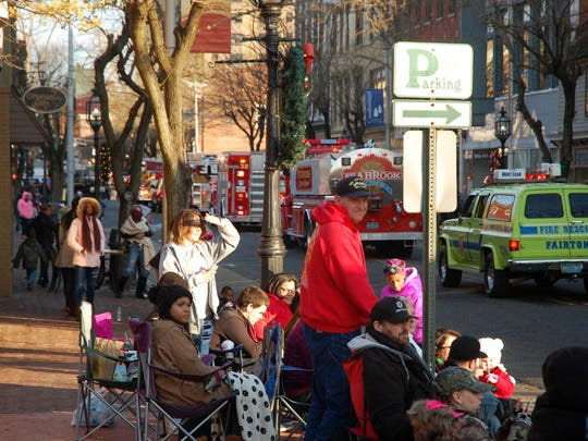 Spectators watch the Bridgeton holiday parade go by.