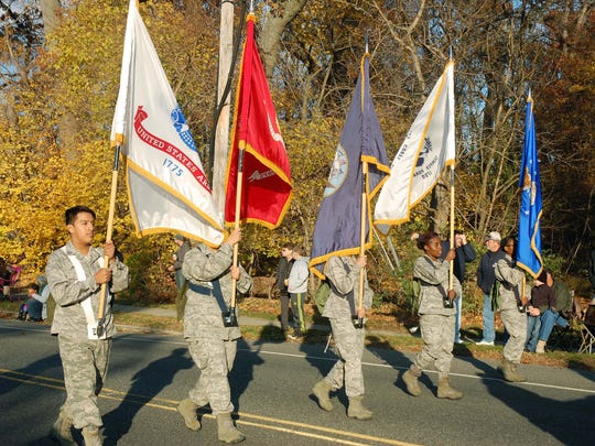 Parade participants salute the branches of the military and those who serve and have served.