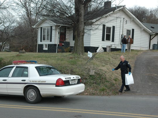 Police remove evidence after arresting Lemaricus Davidson at 1800 Reynolds St. on Thursday,  Jan. 11, 2007. Davidson is charged with slayings of Christopher Newsom, 23, and Channon Christian, 21.