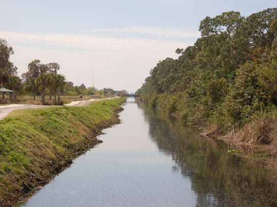 The John Yarbrough Linear Park Trail rolls along the Ten Mile Canal. It has covered picnic tables, and a paved pathway of about six miles stretching from Fort Myers' Colonial Boulevard south to Six Mile Cypress Parkway. Phonethip: For locating this trail, see the addresses of businesses near both ends of this north-south trail .. the addresses are on the other John Yarbrough trail photo.