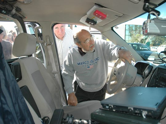 Tony Gacetta checks out a Marco Island police car from the inside, as Jim Atkinson looks on during a prior Marco Island citizens academy. The Marco Island Police Department is hosting an intermediate citizens academy in early April.