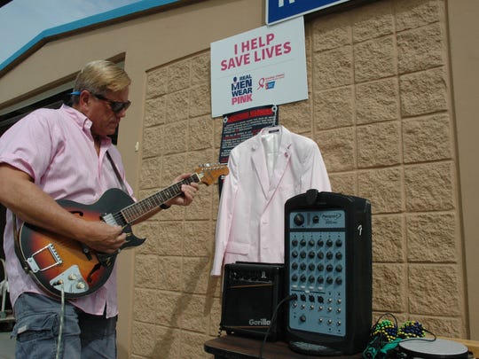 Deputy County Administrator Robert Adolphe played guitar Friday during a St. Lucie County employee-appreciation picnic. Adolphe died Saturday, March 11, 2017.