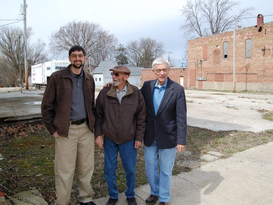 The new West Lebanon Development Group is working to redevelop three adjoining lots left vacant when three storefronts burned in 2011. Mike Klewicki (left), Larry Townsend and Ken Smith, shown here standing at the site on High Street, are involved in the project. The goal is to buy the lots, then create a small park-like area for the community. Future projects for the not-for-profit development corporation may involve stabilizing dilapidated storefronts and offering them, rent-free, to people willing to bring new businesses to the Warren County community.