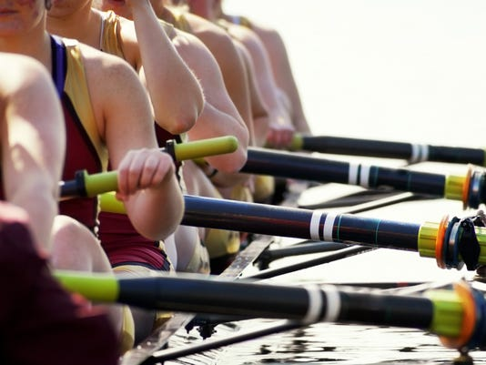 Close-up of women's rowing team blown-out