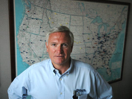 Pilot Travel Centers CEO Jimmy Haslam stands in front of a map showing where each of the company's travel centers are located on Oct. 16, 2006. Pilot is planning an expansion into international markets with its first travel center near Ontario, Canada.