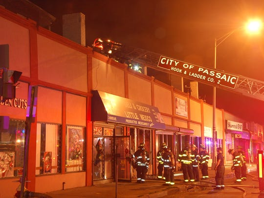 Passaic City firefighters on the scene of a fire at