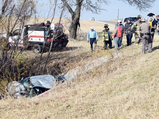 In this file photo, emergency personnel work the scene of a single-vehicle accident on U.S. Highway 287 between Bowie and Bellevue.