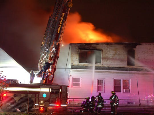 In this Nov. 28, 2015, file photo, a two-alarm fire tears through the second floor of a residence at 86 Belmont Ave. in Belleville.
