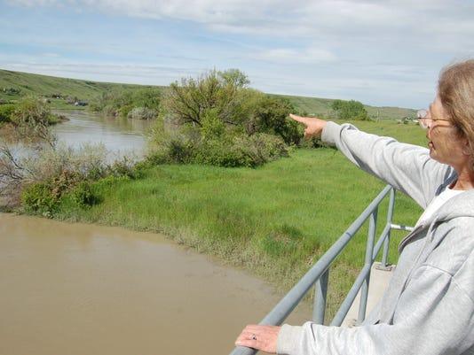 Sun River high, but flood dike is higher