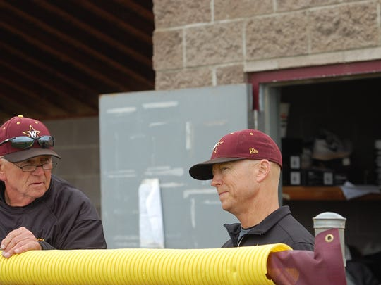 Bob Deal, left, talks strategy with his son Brad Deal, Windsor's head baseball coach on Saturday.