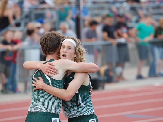 Heritage Christian's Levi Kilian, left, and Seth Bruxvoort are shown at last year's state track meet. Bruxvoort won and Kilian finished fourth at Saturday's state cross country meet to help their team win the Class 1A/2A state title.