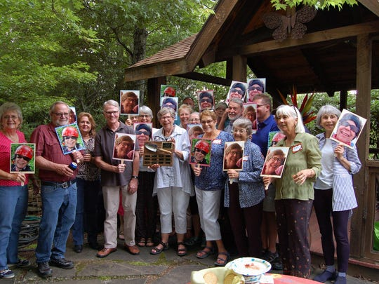 Members of the Black Mountain Beautification Committee hold photos of Libba Fairleigh, center, the winner of this year's Willie Headley Award.