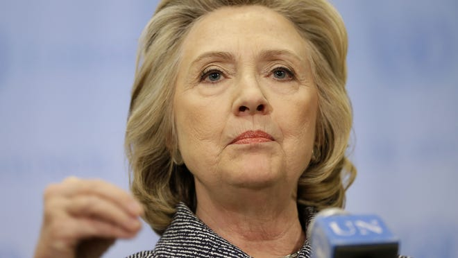 """Hillary Clinton speaks to reporters at United Nations headquarters Tuesday. Clinton conceded that she should have used a government email to conduct business as secretary of state, saying her decision was simply a matter of """"convenience."""""""