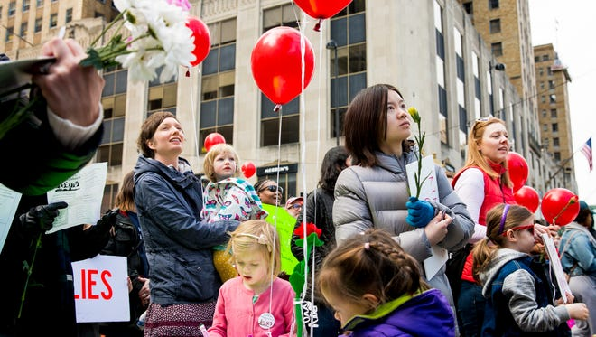 Hundreds gather at Fountain Square to participate in the Children's Kindness March Saturday, February 18, 2017. The march's mission was to show children a positive message in light of all the negativity and bullying in the world.
