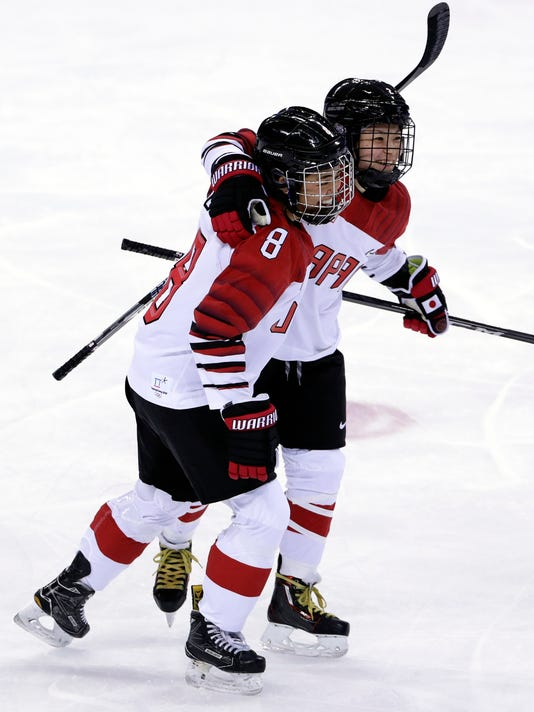Shiori Koike celebrates with Akane Hosoyamada (8), of Japan, after scoring a goal against the combined Koreas during the third period of the preliminary round of the women's hockey game at the 2018 Winter Olympics in Gangneung, South Korea, Wednesday, Feb. 14, 2018. (AP Photo/Frank Franklin II)