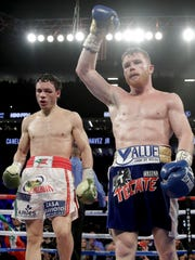 Canelo Alvarez, right, celebrates his dominant win over Julio Cesar Chavez Jr. on Saturday night at Las Vegas.