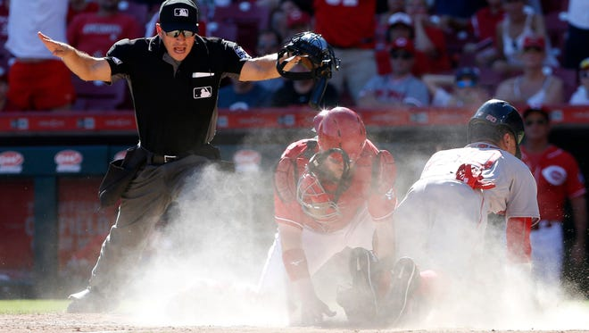 Sep 24, 2017; Cincinnati, OH, USA; Boston Red Sox right fielder Mookie Betts (50) scores the go-ahead run against Cincinnati Reds catcher Tucker Barnhart (16) during the eighth inning at Great American Ball Park. Mandatory Credit: David Kohl-USA TODAY Sports