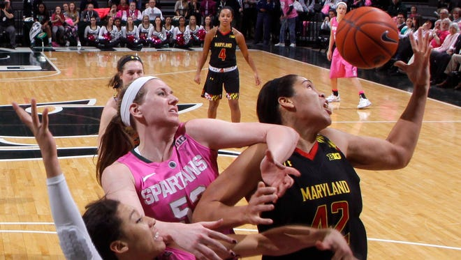 Michigan State's Aerial Powers (23) and Becca Mills, center, and Maryland's Brionna Jones, right, battle for a rebound during the second half on Feb. 16, 2015, in East Lansing. Maryland won 75-69.