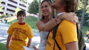 Boston College incoming freshman Oliver Maarraoui, at right, is hugged by his mom Carla Maarraoui close to the end of the three-day orientation.