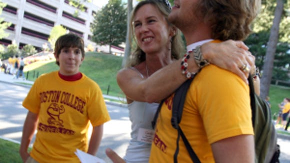 Boston College incoming freshman Oliver Maarraoui, at right, is hugged by his mom Carla Maarraoui close to the end of the 3 day orientation. (Mark Garfinkel, USA TODAY)