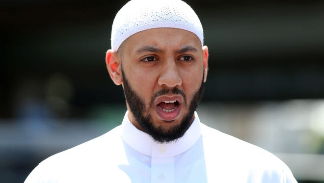 Mohammed Mahmoud, an imam at Finsbury Park Mosque, gives a statement to the media at a police cordon in the Finsbury Park area of north London on June 19, 2017.