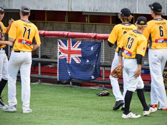 The Australian flag decorates the visitor's dugout