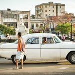 A driver waits for passengers in his old American car in Havana, Cuba on Jan. 20, 2015.