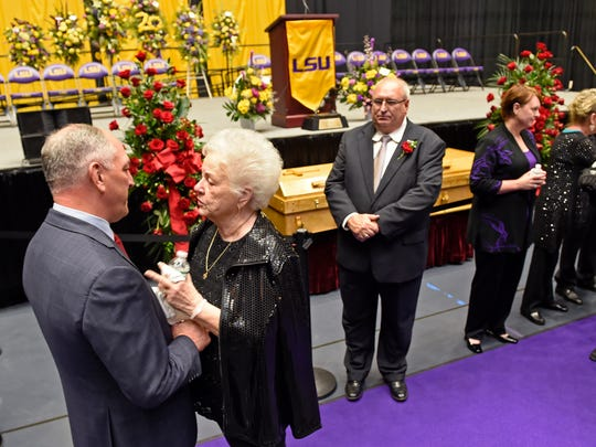 "Louisiana Gov. John Bel Edwards, left, meets with Dorothy ""Dot"" Cannon during the visitation and funeral for former LSU football star Billy Cannon at Pete Maravich Assembly Center on the LSU campus Wednesday, May 23, 2018, in Baton Rouge, La. Cannon, a 1959 Heisman Trophy winner, died at his home early Sunday morning at the age of 80."