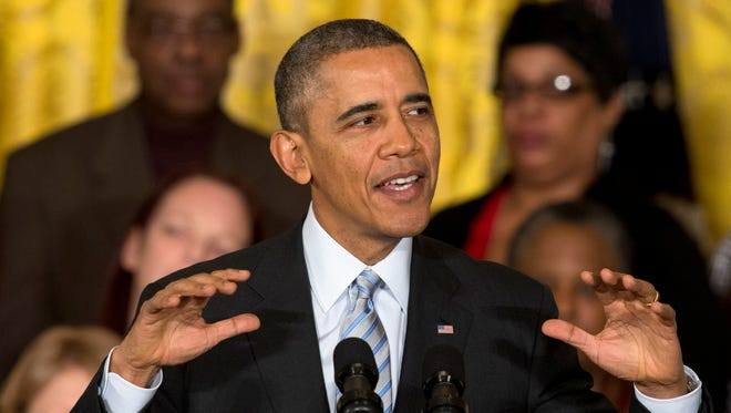 In this Feb. 12, 2014 file photo, President Barack Obama speaks in the East Room of the White House in Washington.  Obama and Vice President Biden will meet again on Friday with Democratic governors.